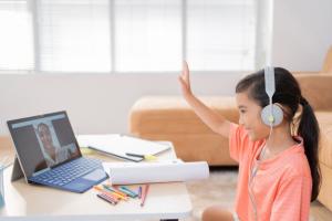 a little girl learning online